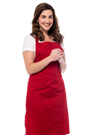 clasped hands: Happy female chef with clasped hands Stock Photo