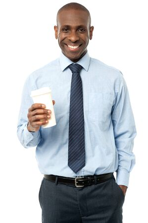 disposable cup: Smiling male executive with disposable cup over white Stock Photo