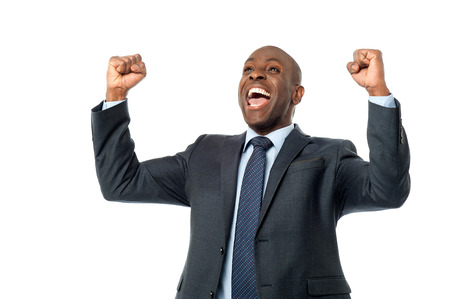 clenching: Successful male entrepreneur clenching his fists over white