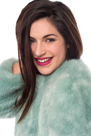 woman in fur coat: Image of a beautiful woman with luxurious fur coat Stock Photo