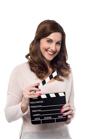 clap board: Smiling woman holding film clap board over white Stock Photo