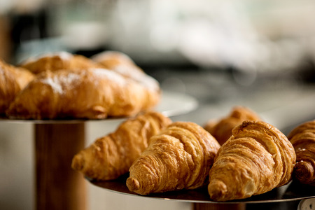 displayed: Fresh and tasty croissants displayed on plate. Stock Photo