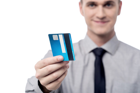 Male executive showing his credit card, focus on card. photo