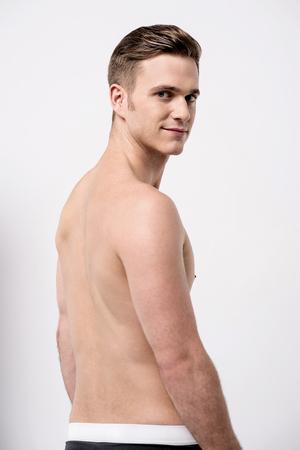 over the shoulder: Shirtless male model looking over shoulder