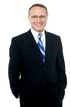 hands on pockets: Successful businessman with hands in pockets Stock Photo