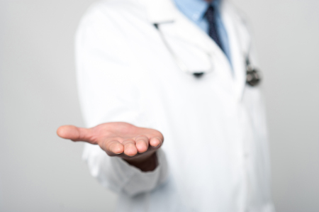 cropped: Cropped image of male doctor shows empty palm Stock Photo
