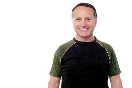 casuals: Mature man posing in casuals and smiling to camera