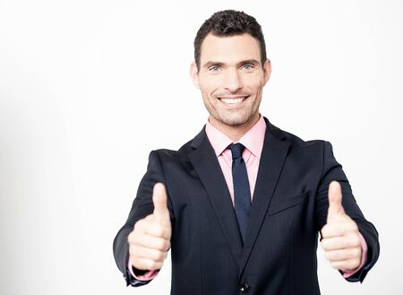 posing  agree: Successful businessman showing double thumbs up Stock Photo