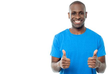 man thumbs up: Smiling man showing double thumbs up to the camera Stock Photo