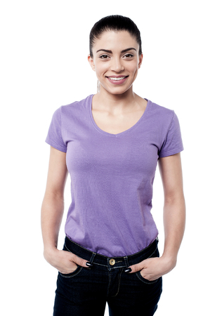 hands on pockets: Happy woman standing with hands in pockets Stock Photo
