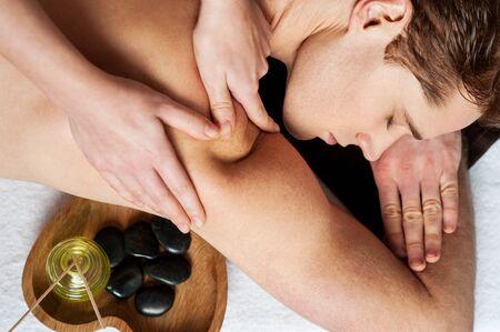 lastone therapy: Man enjoying a wellness back massage in a spa