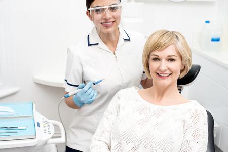 Happy woman patient sitting at stomatology clinic Stock Photo