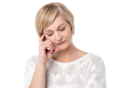 eyesclosed: Thoughtful woman posing over white background