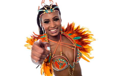costumed: Smiling carnival costumed woman pointing