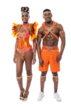 african american woman smiling: Samba dancers posing to camera on white background