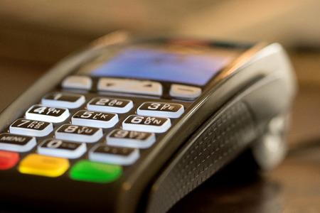 swipe: Close up image of credit card swipe machine