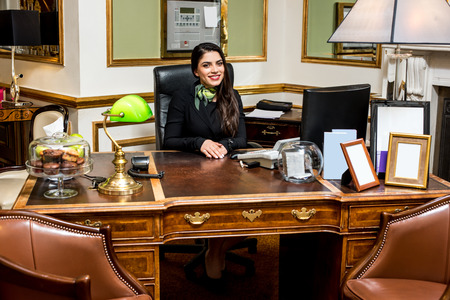 hotel staff: Happy professional woman receptionist in a hotel