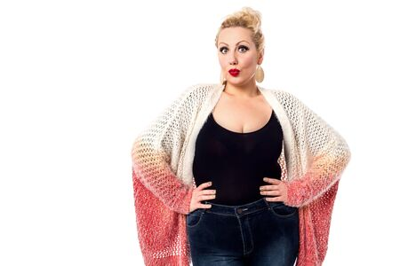 puckered lips: Stylish woman posing with knitted apparel over white