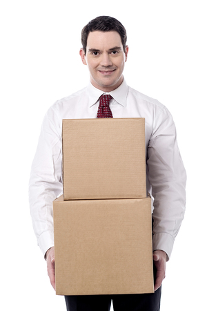 cajas de carton: Corporate man carrying a cardboard boxes in hand