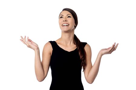 wide open spaces: Happy woman open her arms wide and looking up Stock Photo