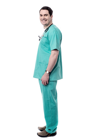 health care: Side pose of smiling male doctor standing over white Stock Photo