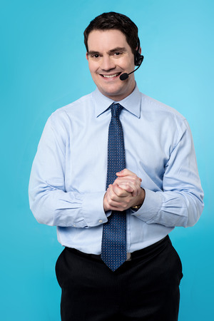 clasped hands: Customer support executive male with clasped hands