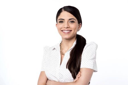 folded arms: Pretty smiling woman posing with folded arms