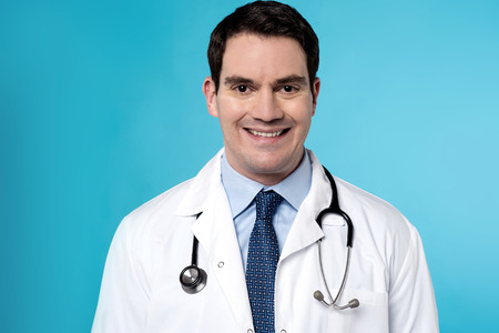 surgical coat: Male physician with stethoscope around his neck Stock Photo