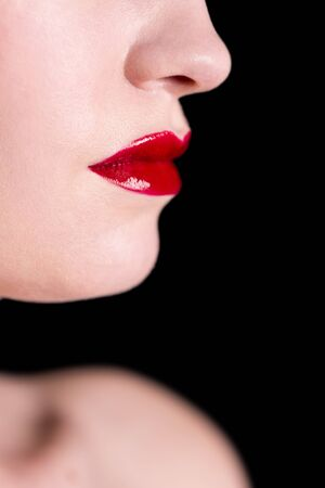 seductive women: Close-up shot of woman lips with glossy red lipstick