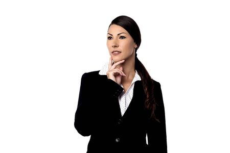 skepticism: Thoughtful businesswoman looking at copy space