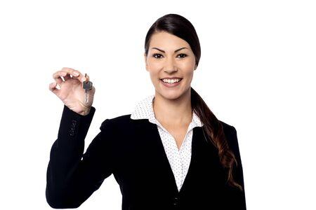 realtor: Beautiful female realtor showing a house key