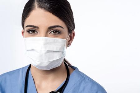 antifaz: Cirujano de sexo femenino que presenta con la m�scara quir�rgica