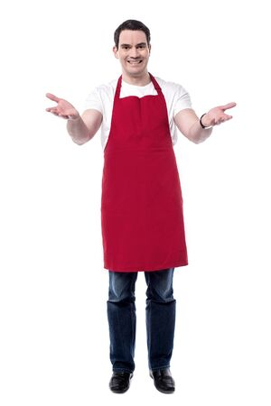 wide open: Full length of happy male chef with wide open arms. Stock Photo
