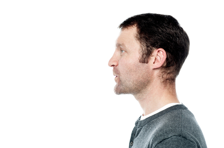 side pose: Side pose of middle aged man looking forward Stock Photo