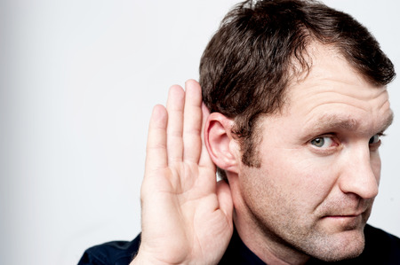 hearsay: Close up of man secretly listening on conversation