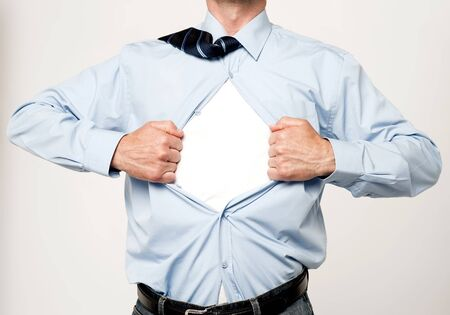 tearing: Cropped image of an executive tearing his shirt