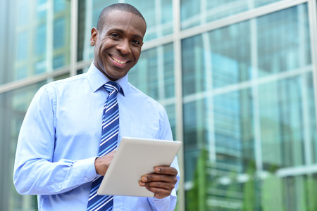 Middle aged businessman using tablet at outdoors Stockfoto