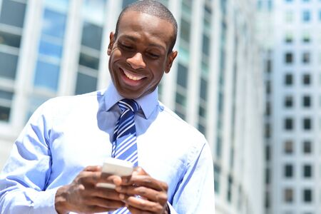 Businessman sending message on his cell phone