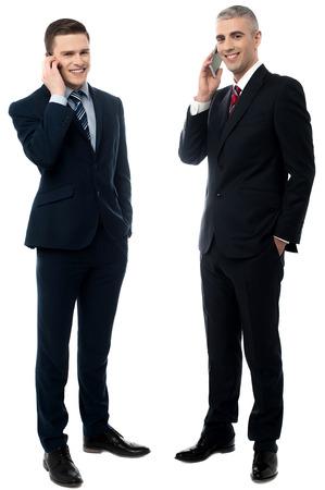 phone professional: Portrait of handsome businessmen communicating via cellphone