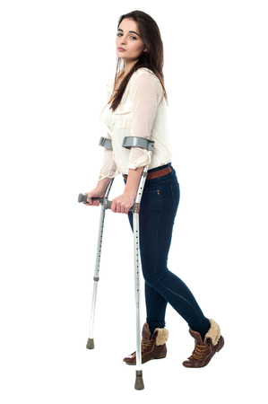 crutches: Full length image of teen walking with crutches