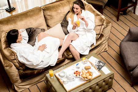 lap of luxury: Relaxed young female friends , aerial view. Stock Photo