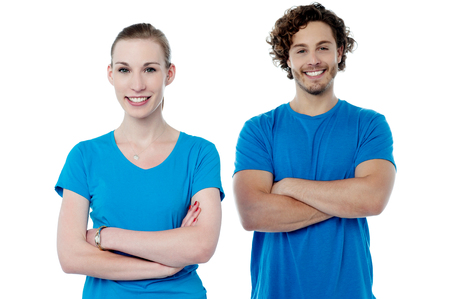 Young friends posing with folded arms. Stock Photo