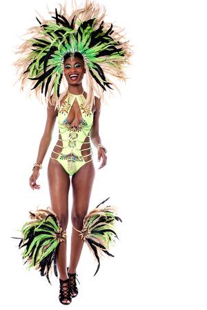 full length: Full length of samba dancer walking forward