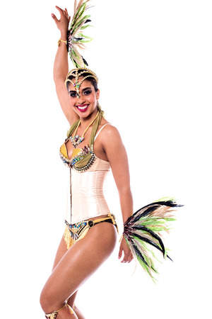 carnival costume: Beautiful woman posing in carnival costume over white