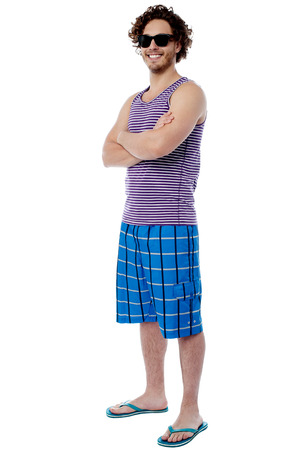 casual wear: Casual male in beach wear and sunglasses