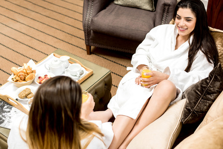 lap of luxury: Top view of women chatting each other Stock Photo