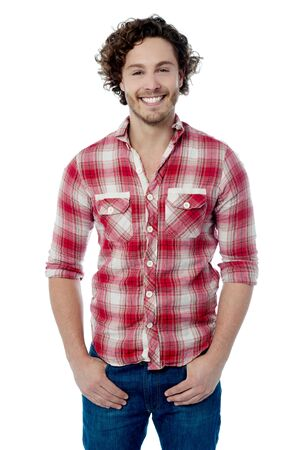 casual wear: Smiling young man posing in casual wear