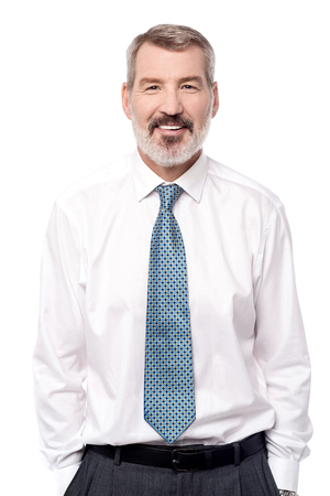 hands on pockets: Smiling corporate male with hands in pockets Stock Photo