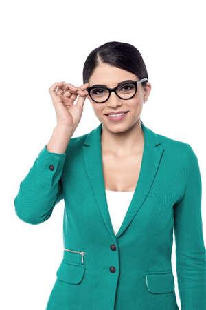 adjusting: Image of a business woman adjusting her eye glasses Stock Photo