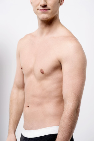 cropped: Cropped image of shirtless young male posing Stock Photo